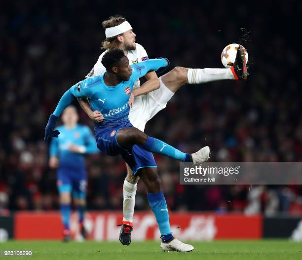 Danny Welbeck of Arsenal and Tom Pettersson of Ostersunds FK during UEFA Europa League Round of 32 match between Arsenal and Ostersunds FK at the...