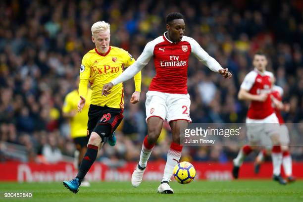 Danny Welbeck of Arsenal and Will Hughes of Watford during the Premier League match between Arsenal and Watford at Emirates Stadium on March 11 2018...