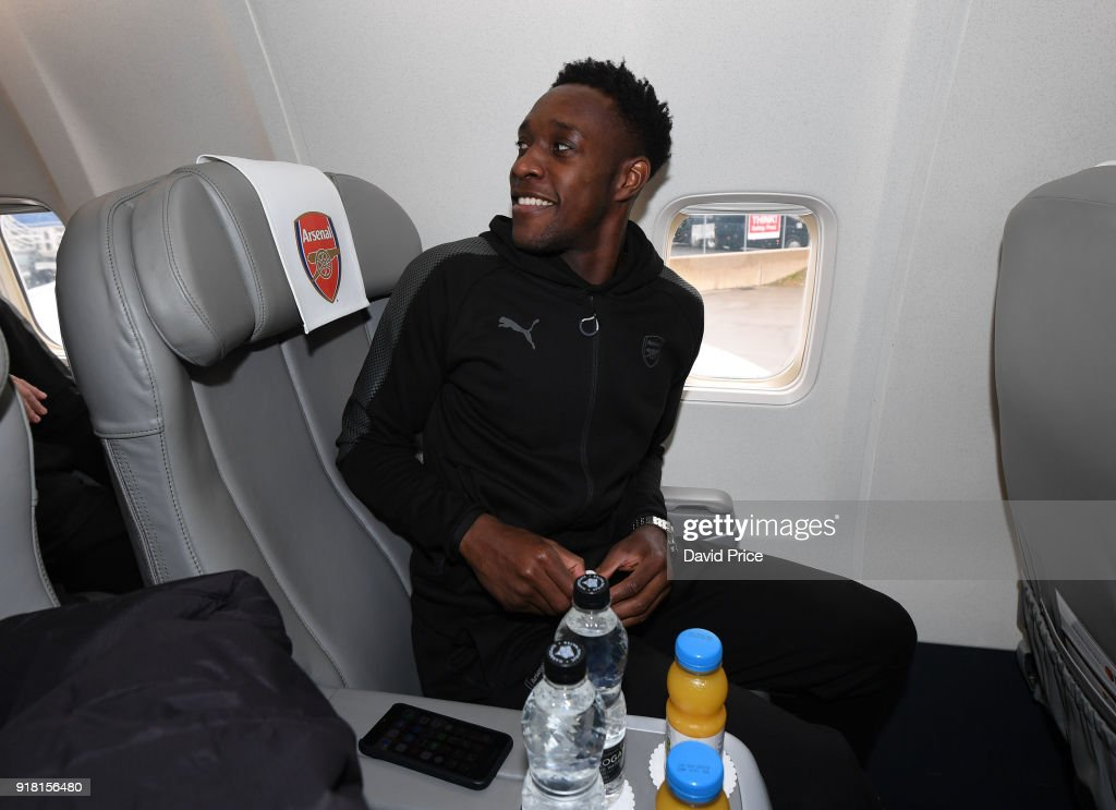 Danny Welbeck of Arsenal boards the plane for the flight to Sweden at Luton Airport on February 14, 2018 in Luton, England.