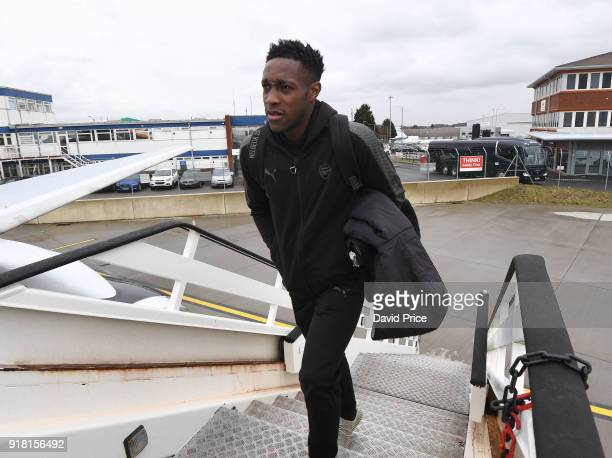 Danny Welbeck of Arsenal boards the plane for the flight to Sweden at Luton Airport on February 14 2018 in Luton England
