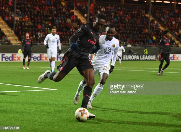 Danny Welbeck of Arsenal breaks past Samuel Mensah of Ostersunds during UEFA Europa League Round of 32 match between Ostersunds FK and Arsenal at the...
