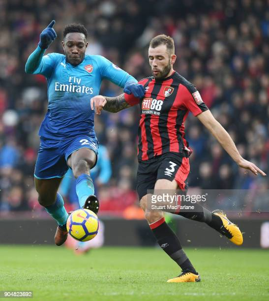 Danny Welbeck of Arsenal breaks past Steve Cook of Bournemouth during the Premier League match between AFC Bournemouth and Arsenal at Vitality...