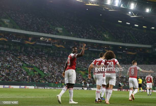 Danny Welbeck of Arsenal celebrates after scoring a goal during the UEFA Europa League Group E match between Sporting CP and Arsenal at Estadio Jose...