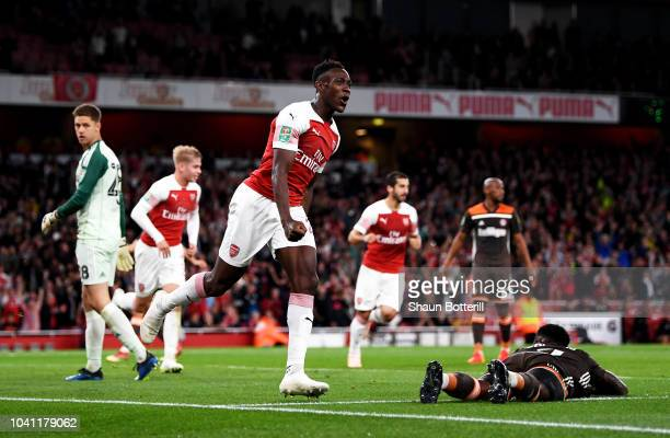Danny Welbeck of Arsenal celebrates after scoring his team's second goal during the Carabao Cup Third Round match between Arsenal and Brentford at...