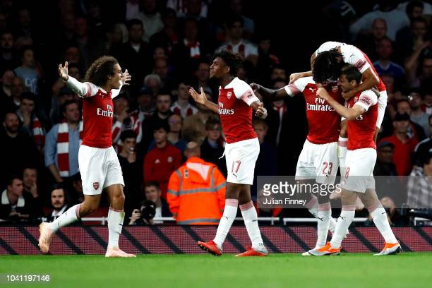 Danny Welbeck of Arsenal celebrates after scoring his team's second goal with his team mates during the Carabao Cup Third Round match between Arsenal...