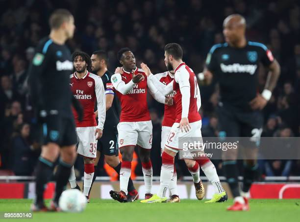 Danny Welbeck of Arsenal celebrates as he scores their first goal with team mates during the Carabao Cup QuarterFinal match between Arsenal and West...