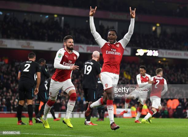 Danny Welbeck of Arsenal celebrates as he scores their first goal with team mate Olivier Giroud during the Carabao Cup QuarterFinal match between...