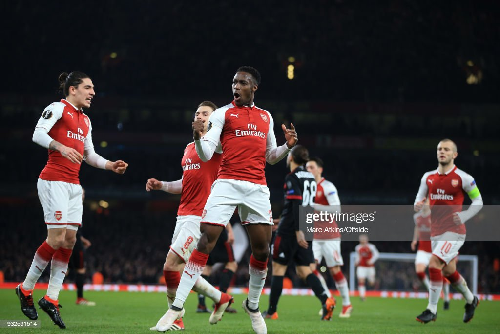 Danny Welbeck of Arsenal celebrates scoring his 1st goal with Hector Bellerin during the UEFA Europa League Round of 16 2nd leg match between Arsenal and AC MIian at Emirates Stadium on March 15, 2018 in London, England.