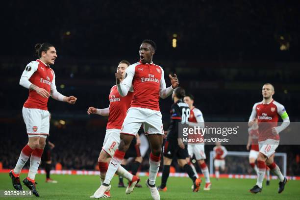Danny Welbeck of Arsenal celebrates scoring his 1st goal with Hector Bellerin during the UEFA Europa League Round of 16 2nd leg match between Arsenal...