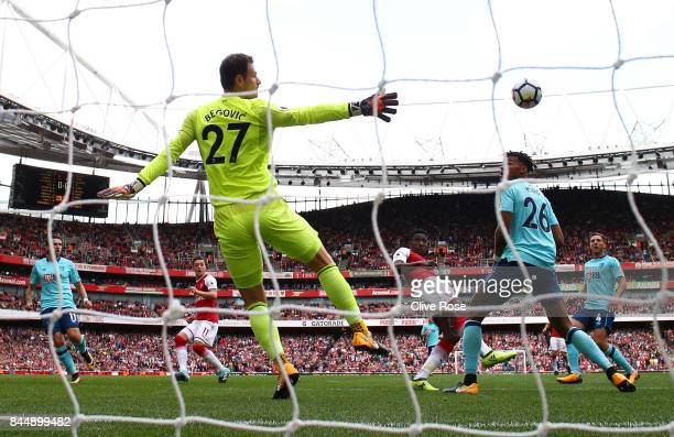 Danny Welbeck of Arsenal celebrates scoring his sides first goal past Asmir Begovic of AFC Bournemouth during the Premier League match between...