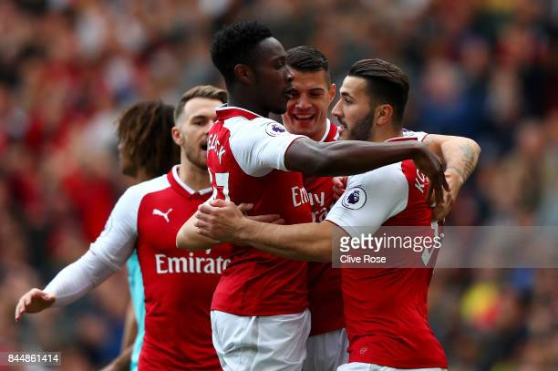 Danny Welbeck of Arsenal celebrates scoring his sides first goal with Granit Xhaka of Arsenal and Sead Kolasinac of Arsenal during the Premier League...