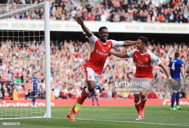 Danny Welbeck of Arsenal celebrates scoring his sides second goal with Alexis Sanchez of Arsenal during the Premier League match between Arsenal and...