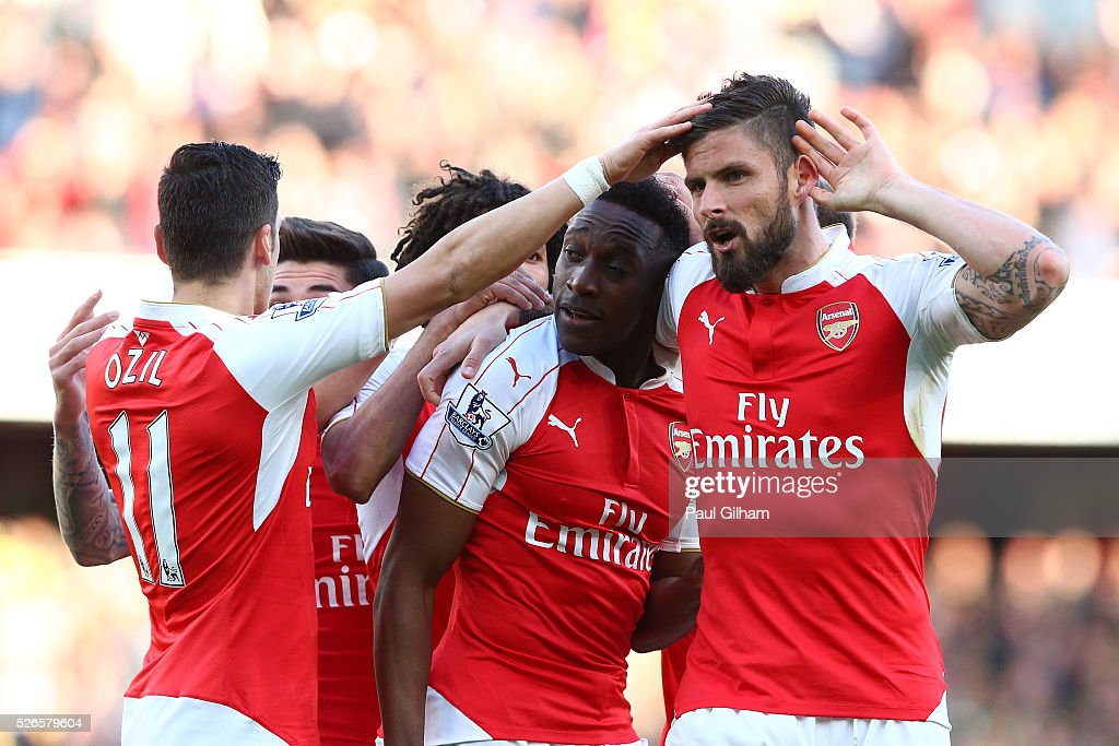Danny Welbeck of Arsenal celebrates scoring the opening goal with Olivier Giroud (R) during the Barclays Premier League match between Arsenal and Norwich City at The Emirates Stadium on April 30, 2016 in London, England