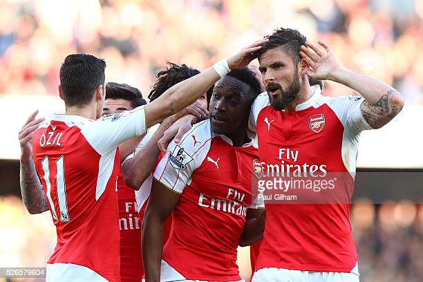 Danny Welbeck of Arsenal celebrates scoring the opening goal with Olivier Giroud during the Barclays Premier League match between Arsenal and Norwich...