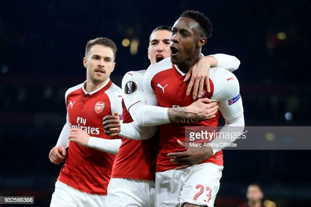 Danny Welbeck of Arsenal celebrates scoring their 1st goal with Aaron Ramsey and Hector Bellerin during the UEFA Europa League Round of 16 2nd leg...
