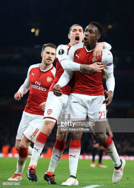 Danny Welbeck of Arsenal celebrates scoring their 1st goal with Hector Bellerin and Aaron Ramsey during the UEFA Europa League Round of 16 2nd leg...