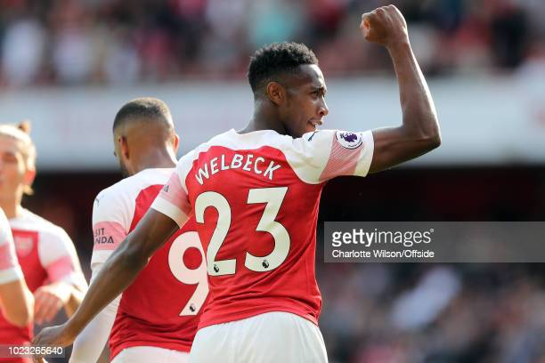 Danny Welbeck of Arsenal celebrates scoring their 3rd goal during the Premier League match between Arsenal FC and West Ham United at Emirates Stadium...