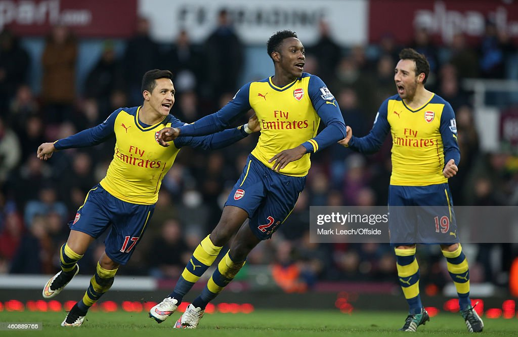 Danny Welbeck of Arsenal celebrates the second goal with Alexis Sanchez and Santi Cazorla during the Barclays Premier League match between West Ham United and Arsenal at the Boleyn Ground on December 28, 2014 in London, United Kingdom.