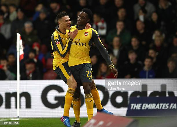 Danny Welbeck of Arsenal celebrates with Kieran Gibbs of Arsenal after scoring his sides first goal during the Emirates FA Cup Fourth Round match...