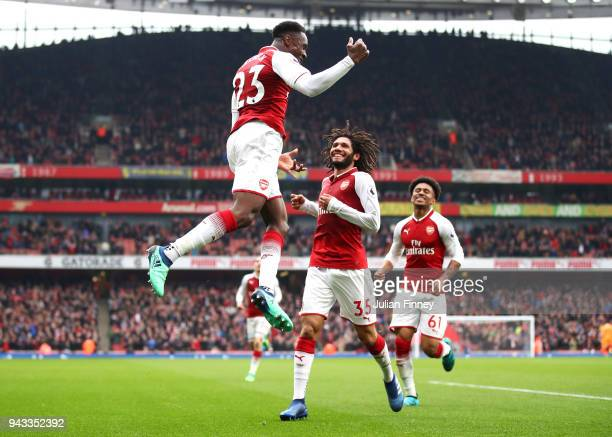 Danny Welbeck of Arsenal celebrates with team mate Mohamed Elneny and Reiss Nelson after scoring his sides second goal during the Premier League...