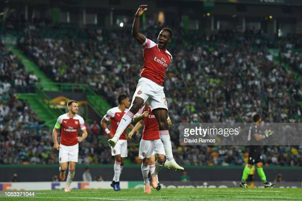 Danny Welbeck of Arsenal celebrates with team mates after scoring his sides first goal during the UEFA Europa League Group E match between Sporting...