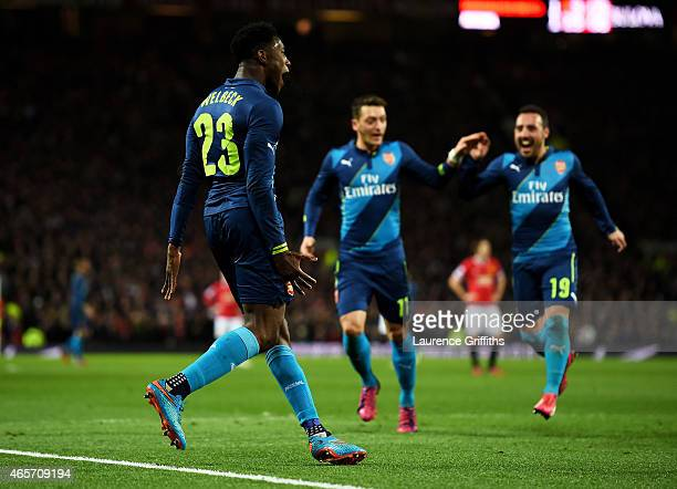 Danny Welbeck of Arsenal celebrates with teammates Mesut Oezil and Santi Cazorla of Arsenal after scoring his team's second goal during the FA Cup...
