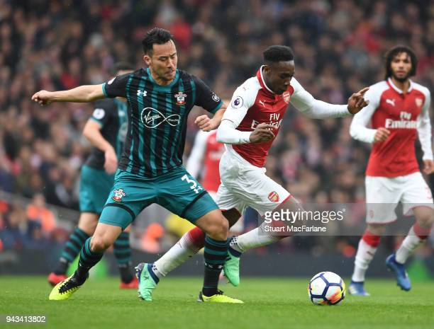 Danny Welbeck of Arsenal challenged by Maya Yoshida of Southampton during the Premier League match between Arsenal and Southampton at Emirates...