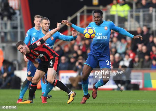 Danny Welbeck of Arsenal challenges Dan Gosling of Bournemouth during the Premier League match between AFC Bournemouth and Arsenal at Vitality...