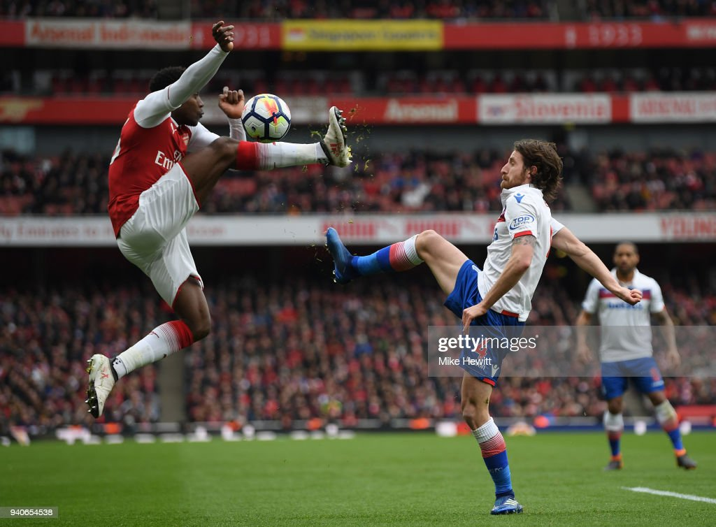 Danny Welbeck of Arsenal challenges Joe Allen of Stoke City during the Premier League match between Arsenal and Stoke City at Emirates Stadium on April 1, 2018 in London, England.