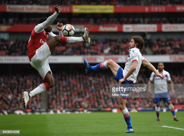 Danny Welbeck of Arsenal challenges Joe Allen of Stoke City during the Premier League match between Arsenal and Stoke City at Emirates Stadium on...