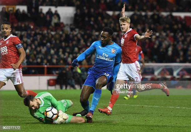 Danny Welbeck of Arsenal challenges Jordan Smith of Forest leading to the 2nd Arsenal goal during the Emirates FA Cup 3rd Round match between...