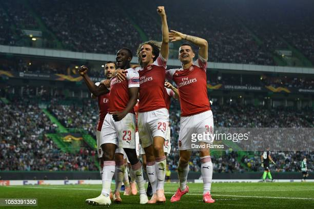 Danny Welbeck of Arsenal FC celebrates with his team mates after scoring his team's first goal during the UEFA Europa League Group E match between...