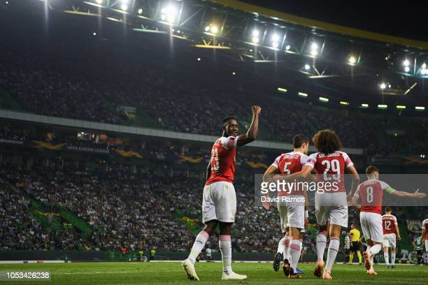 Danny Welbeck of Arsenal FC celebrates with his team mates after scoring his team's first goalduring the UEFA Europa League Group E match between...