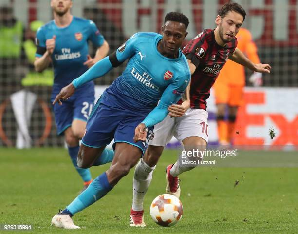 Danny Welbeck of Arsenal FC competes for the ball with Hakan Calhanoglu of AC Milan during UEFA Europa League Round of 16 match between AC Milan and...