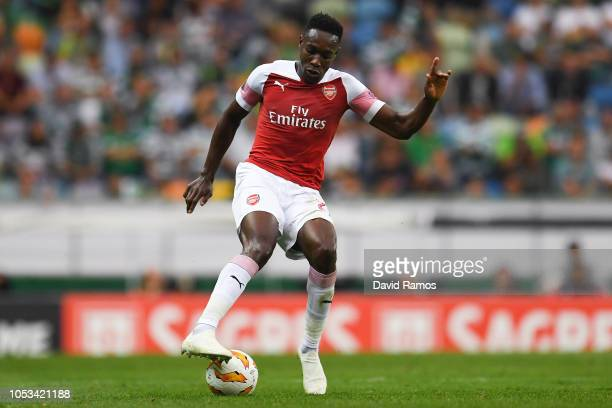 Danny Welbeck of Arsenal FC runs with the ball during the UEFA Europa League Group E match between Sporting CP and Arsenal at Estadio Jose Alvalade...