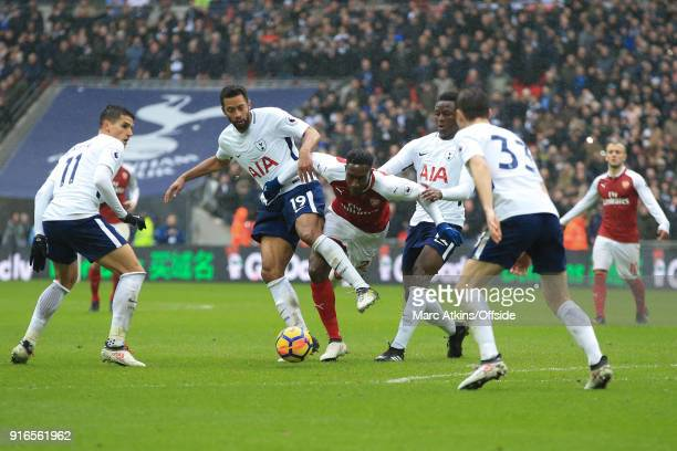 Danny Welbeck of Arsenal goes down under pressure from Victor Wanyama Mousa Dembele Erik Lamela and Ben Davies of Tottenham Hotspur during the...