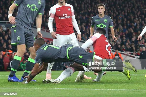 Danny Welbeck of Arsenal goes over awkwardly on his ankle during the UEFA Europa League Group E match between Arsenal and Sporting CP at Emirates...