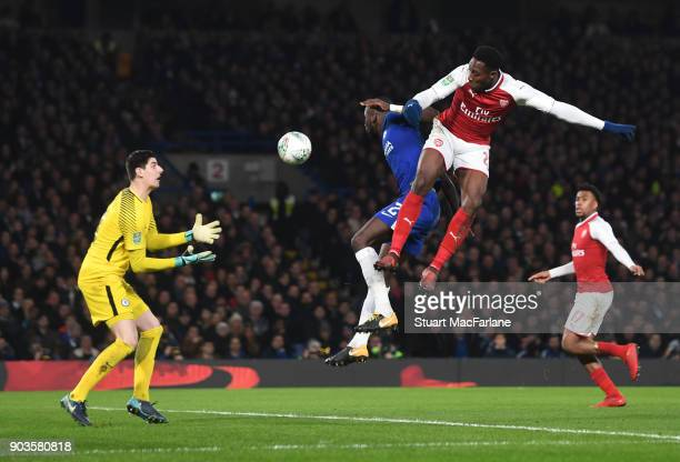 Danny Welbeck of Arsenal has his header saved by Chelsea goalkeeper Thibaut Courtois during the Carabao Cup SemiFinal First Leg match between Chelsea...