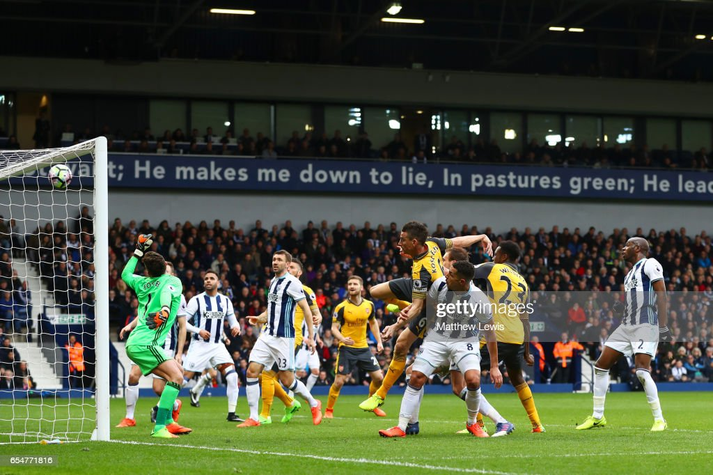 Danny Welbeck of Arsenal (R) heads towards goal during the Premier League match between West Bromwich Albion and Arsenal at The Hawthorns on March 18, 2017 in West Bromwich, England.