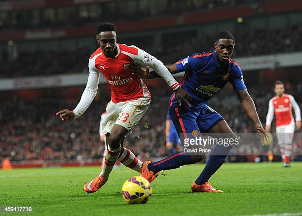 Danny Welbeck of Arsenal holds off Tyler Blackett of Manchester United during the match Arsenal v Manchester United in the Barcleys Premier League at...