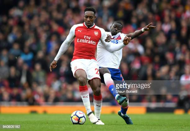 Danny Welbeck of Arsenal is challenged by Badou Ndiaye of Stoke City during the Premier League match between Arsenal and Stoke City at Emirates...