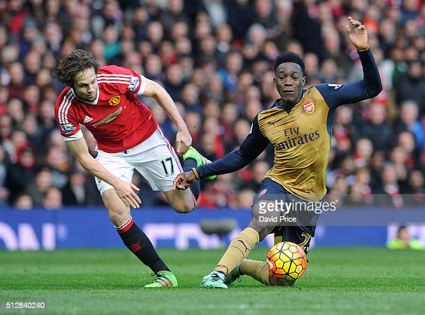 Danny Welbeck of Arsenal is challenged by Daley Blind of Man Utd during the Barclays Premier League match between Manchester United and Arsenal at...