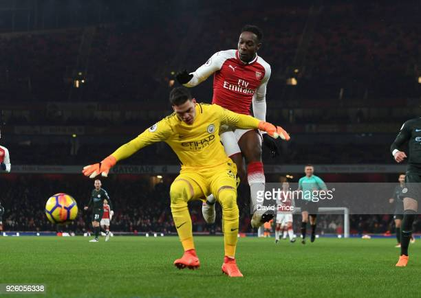 Danny Welbeck of Arsenal is challenged by Ederson of Man City during the Premier League match between Arsenal and Manchester City at Emirates Stadium...