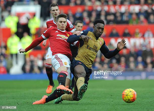 Danny Welbeck of Arsenal is challenged by Guillermo Varela of Man Utd during the Barclays Premier League match between Manchester United and Arsenal...