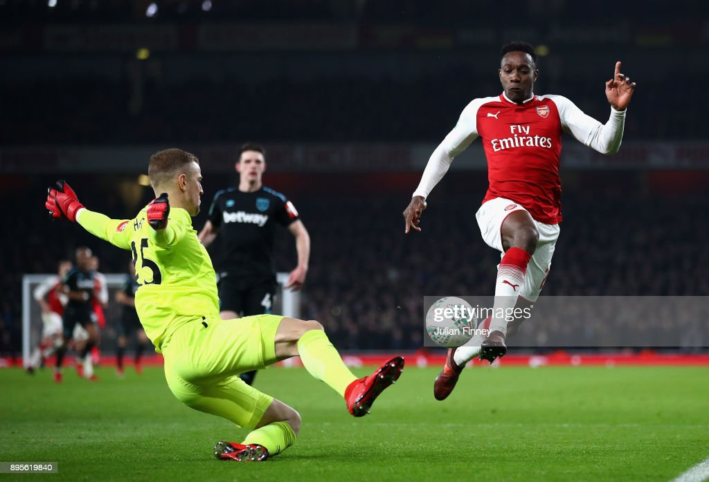 Danny Welbeck of Arsenal is challenged by Joe Hart of West Ham United during the Carabao Cup Quarter-Final match between Arsenal and West Ham United at Emirates Stadium on December 19, 2017 in London, England.