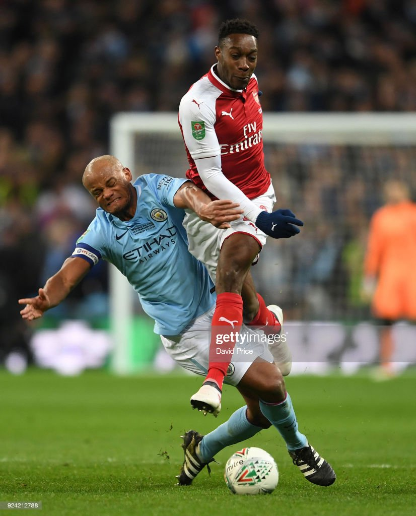 Danny Welbeck of Arsenal is challenged by Vincent Kompany of Man City during the match between Arsenal and Manchester City at Wembley Stadium on February 25, 2018 in London, England.