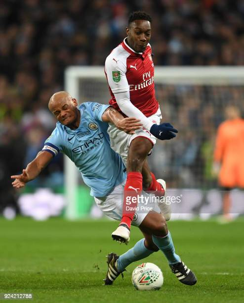 Danny Welbeck of Arsenal is challenged by Vincent Kompany of Man City during the match between Arsenal and Manchester City at Wembley Stadium on...