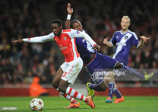 Danny Welbeck of Arsenal is fouled by Chancel Mbemba of Anderlecht to give away a penalty to Arsenal during the match between Arsenal and Anderlecht...