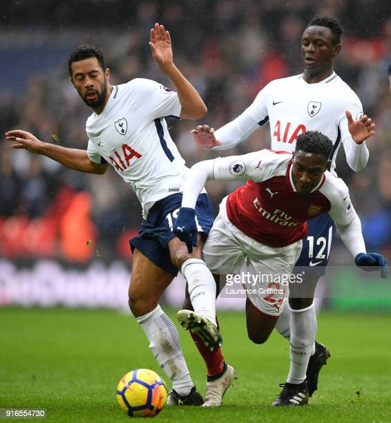 Danny Welbeck of Arsenal is fouled by Mousa Dembele of Tottenham Hotspur and Victor Wanyama of Tottenham Hotspur during the Premier League match...
