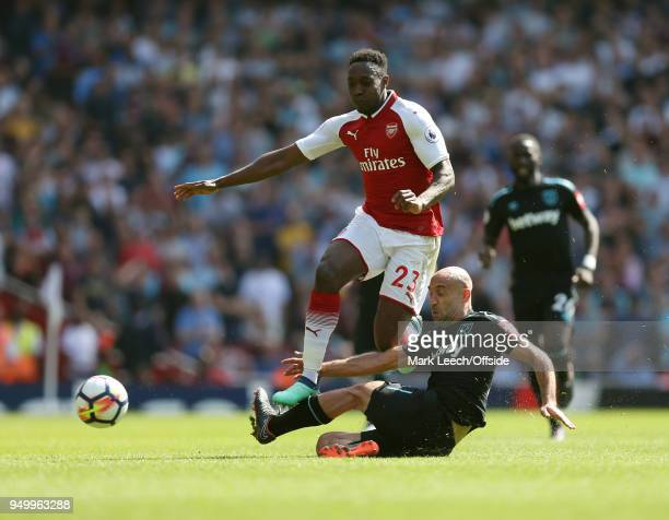 Danny Welbeck of Arsenal is fouled by Pablo Zabaleta of West Ham during the Premier League match between Arsenal and West Ham United at Emirates...